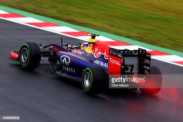 Daniel Ricciardo of Australia and Infiniti Red Bull Racing drives during the Japanese Formula One Grand Prix at Suzuka Circuit on October 5 2014 in...