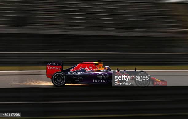 Daniel Ricciardo of Australia and Infiniti Red Bull Racing drives during practice for the Formula One Grand Prix of China at Shanghai International...