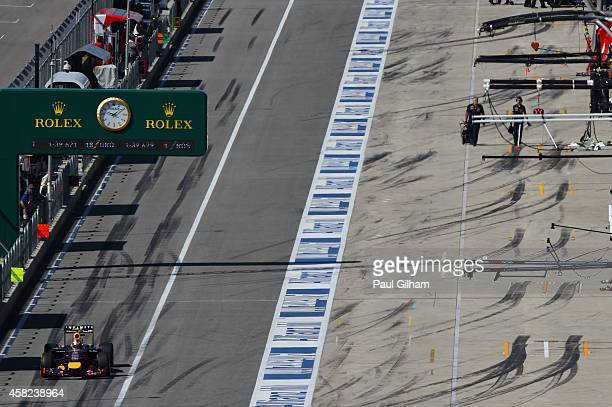 Daniel Ricciardo of Australia and Infiniti Red Bull Racing exits the pit lane during qualifying for the United States Formula One Grand Prix at...