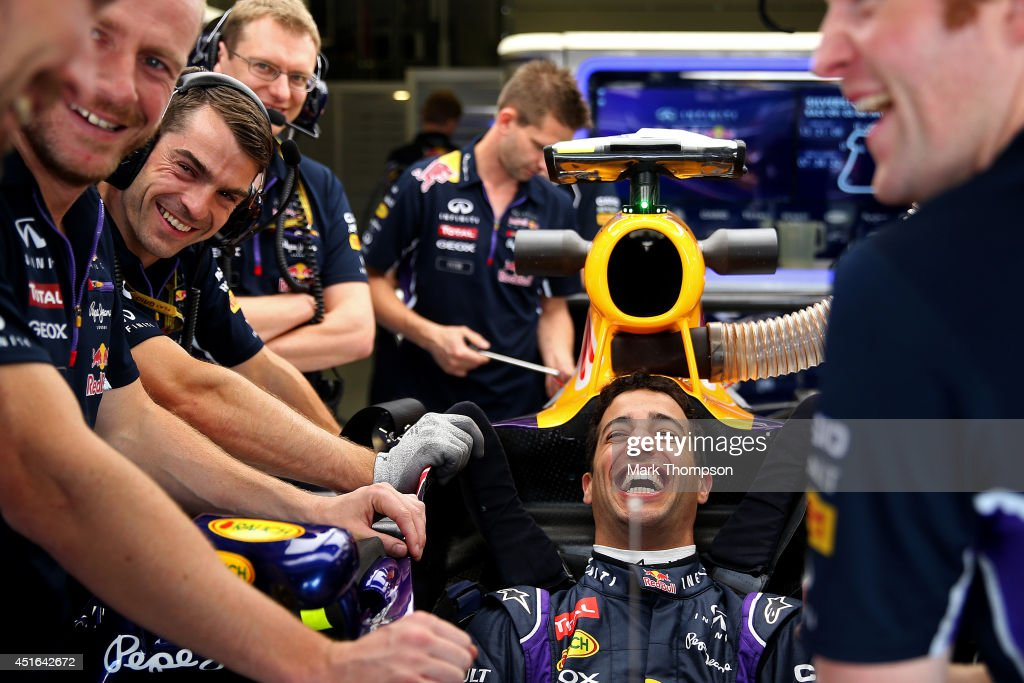 Daniel Ricciardo of Australia and Infiniti Red Bull Racing laughs with members of his team during previews ahead of the British Formula One Grand Prix at Silverstone Circuit on July 3, 2014 in Northampton, United Kingdom.
