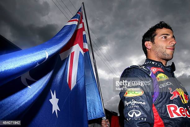 Daniel Ricciardo of Australia and Infiniti Red Bull Racing looks on as he prepares on the grid before the Belgian Grand Prix at Circuit de...