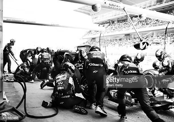 Daniel Ricciardo of Australia and Infiniti Red Bull Racing makes a pit stop during the Spanish Formula One Grand Prix at Circuit de Catalunya on May...