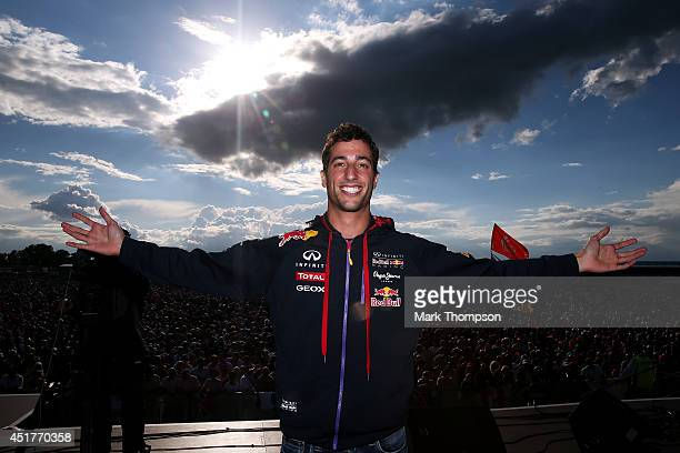 Daniel Ricciardo of Australia and Infiniti Red Bull Racing poses on stage during a fanzone appearance after the British Formula One Grand Prix at...