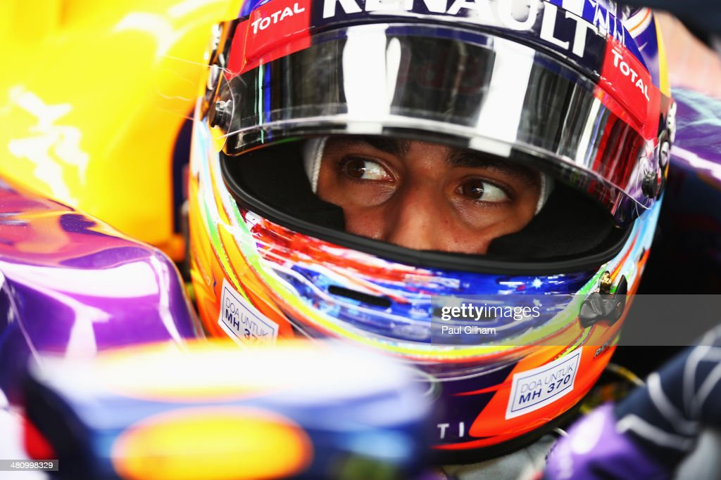 Daniel Ricciardo of Australia and Infiniti Red Bull Racing prepares to drive while wearing an inscription on his helmet in memory of Malaysian Airlines flight MH370 during practice for the Malaysia Formula One Grand Prix at the Sepang Circuit on March 28, 2014 in Kuala Lumpur, Malaysia.