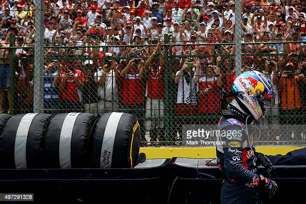 Daniel Ricciardo of Australia and Infiniti Red Bull Racing prepares on the grid before the Formula One Grand Prix of Brazil at Autodromo Jose Carlos...