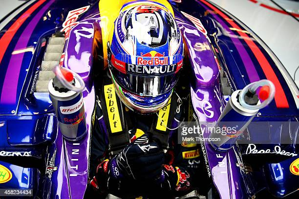 Daniel Ricciardo of Australia and Infiniti Red Bull Racing sits in his car in the garage during qualifying for the United States Formula One Grand...