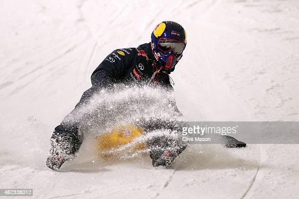 Daniel Ricciardo of Australia and Infiniti Red Bull Racing sledges down a slalom slope during the Red Bull Racing Meet the 2015 Drivers event at the...