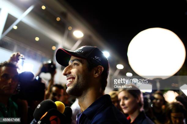 Daniel Ricciardo of Australia and Infiniti Red Bull Racing smiles as he speaks with members of the media during previews ahead of the Singapore...