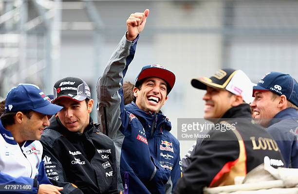 Daniel Ricciardo of Australia and Infiniti Red Bull Racing smiles as he takes part in the drivers' parade before the Formula One Grand Prix of...