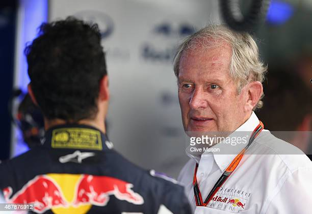 Daniel Ricciardo of Australia and Infiniti Red Bull Racing speaks with team consultant Dr Helmut Marko in the garage during qualifying for the...