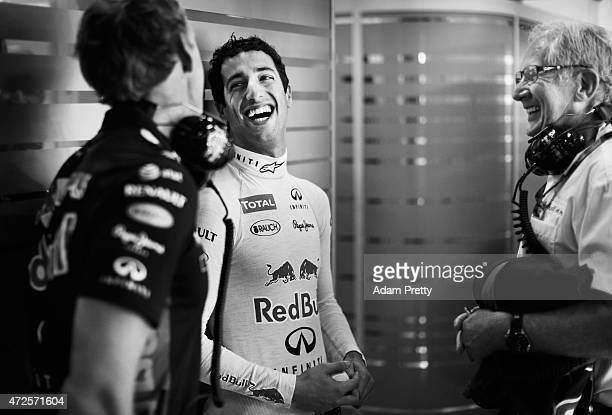 Daniel Ricciardo of Australia and Infiniti Red Bull Racing speaks with Stuart Smith and team consultant Dr Helmut Marko in the garage during practice...