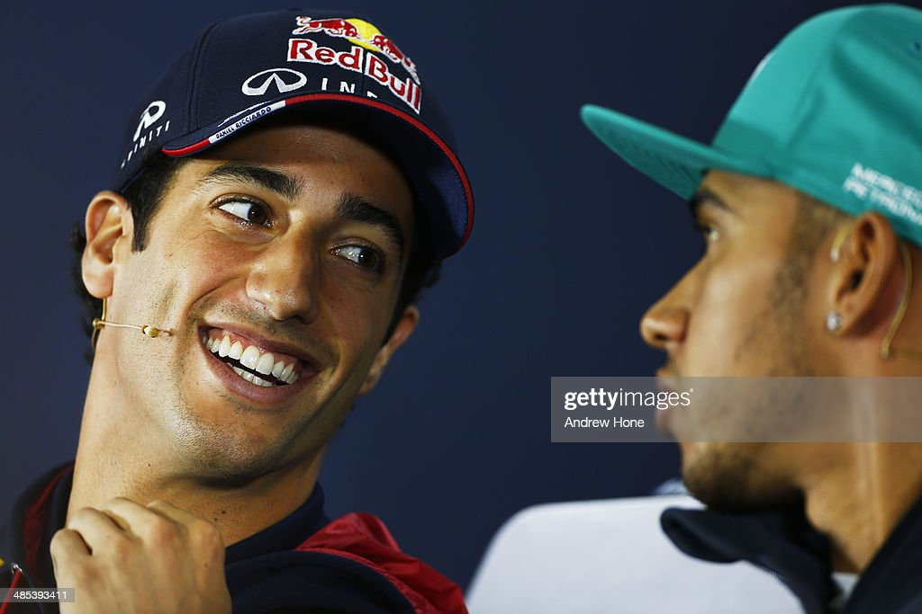 Daniel Ricciardo of Australia and Infiniti Red Bull Racing speaks with Lewis Hamilton of Great Britain and Mercedes GP during a press conference ahead of the Chinese Formula One Grand Prix at the Shanghai International Circuit on April 17, 2014 in Shanghai, China.