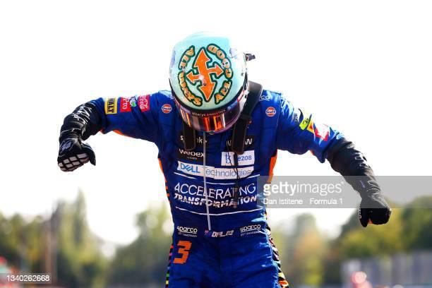Daniel Ricciardo of Australia and McLaren celebrates in parc ferme after winning the F1 Grand Prix of Italy at Autodromo di Monza on September 12,...