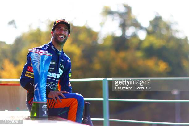 Daniel Ricciardo of Australia and McLaren celebrates on the podium after winning the F1 Grand Prix of Italy at Autodromo di Monza on September 12,...