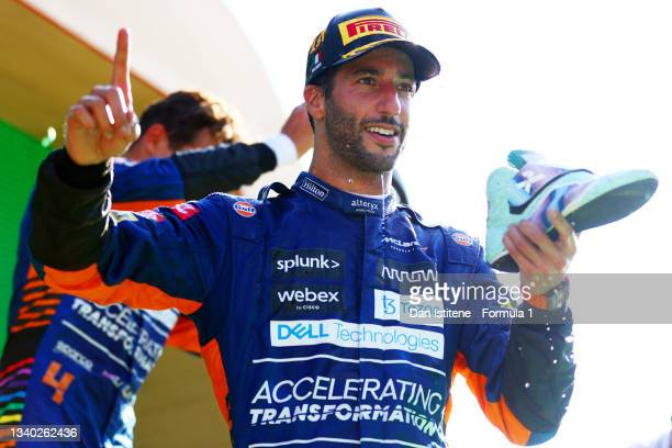 Daniel Ricciardo of Australia and McLaren celebrates with a shoey on the podium after winning the F1 Grand Prix of Italy at Autodromo di Monza on...