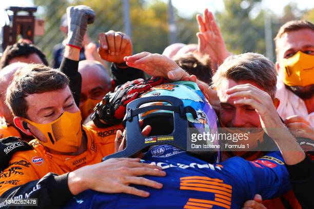 Daniel Ricciardo of Australia and McLaren celebrates with his team in parc ferme after winning the F1 Grand Prix of Italy at Autodromo di Monza on...