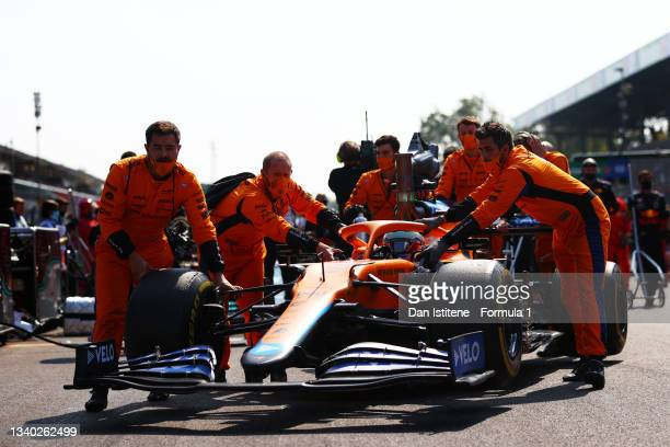 Daniel Ricciardo of Australia and McLaren is pushed on to the grid by his team before the F1 Grand Prix of Italy at Autodromo di Monza on September...