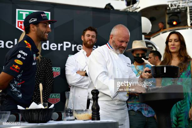 Daniel Ricciardo of Australia and Red Bull Racing Actor Chris Hemsworth and Chef Philippe Etchebest at the TAG Heuer Culinary Challenge on May 27...