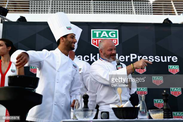 Daniel Ricciardo of Australia and Red Bull Racing and Chef Philippe Etchebest at the TAG Heuer Culinary Challenge on May 27 2017 in MonteCarlo Monaco