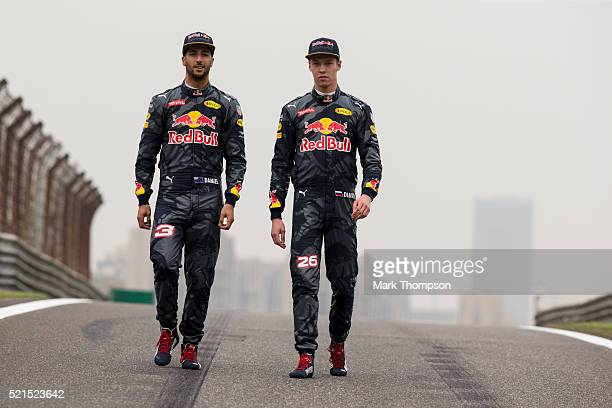 Daniel Ricciardo of Australia and Red Bull Racing and Daniil Kvyat of Russia and Red Bull Racing pose for a photo on the track during previews to the...