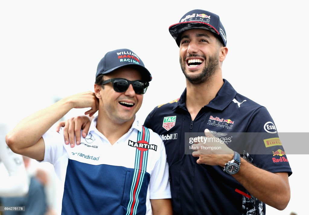 Daniel Ricciardo of Australia and Red Bull Racing and Felipe Massa of Brazil and Williams share a joke in the Paddock during practice for the Canadian Formula One Grand Prix at Circuit Gilles Villeneuve on June 9, 2017 in Montreal, Canada.