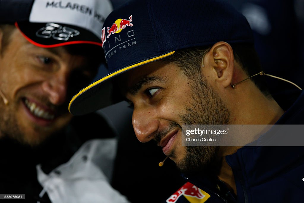 Daniel Ricciardo of Australia and Red Bull Racing and Jenson Button of Great Britain and McLaren Honda talk in the Drivers Press Conference during previews to the Canadian Formula One Grand Prix at Circuit Gilles Villeneuve on June 9, 2016 in Montreal, Canada.
