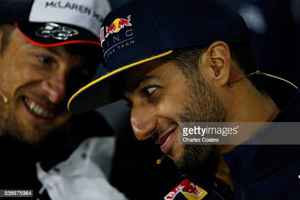 Daniel Ricciardo of Australia and Red Bull Racing and Jenson Button of Great Britain and McLaren Honda talk in the Drivers Press Conference during...