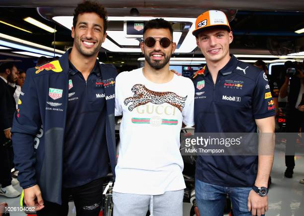 Daniel Ricciardo of Australia and Red Bull Racing and Max Verstappen of Netherlands and Red Bull Racing pose for a photo with Manchester City and...