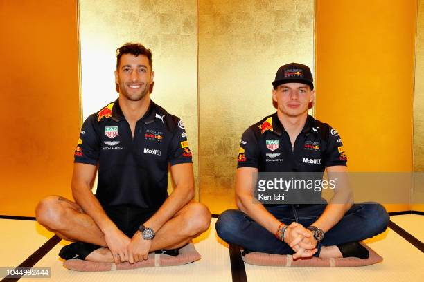 Daniel Ricciardo of Australia and Red Bull Racing and Max Verstappen of Netherlands and Red Bull Racing prepare to learn the Japanese art of Shodo...