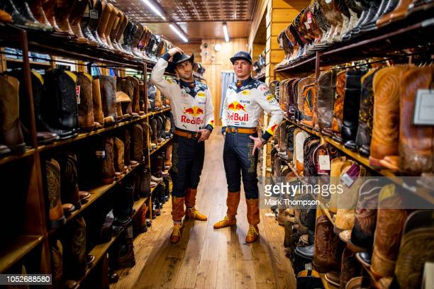 Daniel Ricciardo of Australia and Red Bull Racing and Max Verstappen of Netherlands and Red Bull Racing show off their special edition cowboy styled...