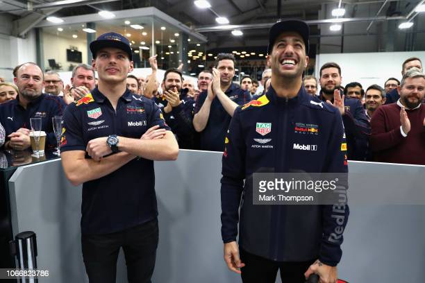 Daniel Ricciardo of Australia and Red Bull Racing and Max Verstappen of Netherlands and Red Bull Racing look on during the Red Bull Racing Drivers...