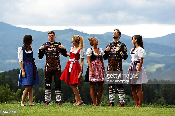 Daniel Ricciardo of Australia and Red Bull Racing and Max Verstappen of Netherlands and Red Bull Racing pose with some Formula Unas girls in their...