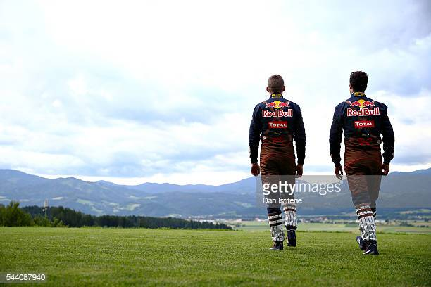 Daniel Ricciardo of Australia and Red Bull Racing and Max Verstappen of Netherlands and Red Bull Racing in their lederhosen themed race suits during...