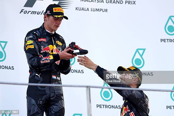 Daniel Ricciardo of Australia and Red Bull Racing and Max Verstappen of Netherlands and Red Bull Racing celebrate on the podium during the Malaysia...