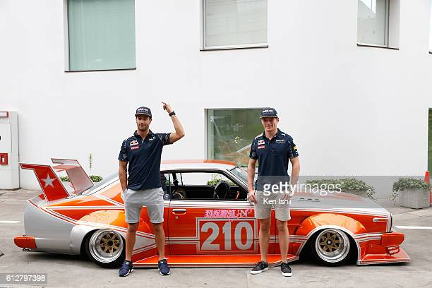 Daniel Ricciardo of Australia and Red Bull Racing and Max Verstappen of Netherlands and Red Bull Racing drive around Tokyo in a Bosozuko Car during...