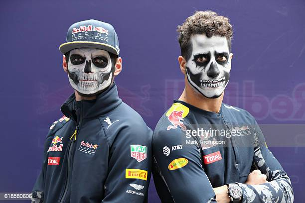 Daniel Ricciardo of Australia and Red Bull Racing and Max Verstappen of Netherlands and Red Bull Racing in full Dia de Muertos face paint during...