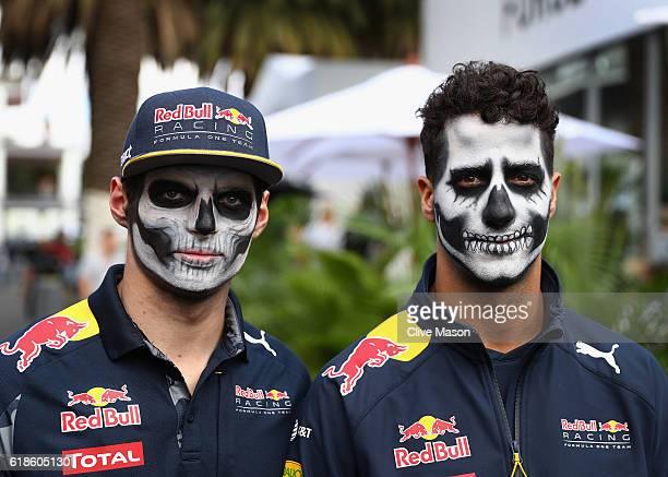 Daniel Ricciardo of Australia and Red Bull Racing and Max Verstappen of Netherlands and Red Bull Racing walk in the Paddock in full Dia de Muertos...