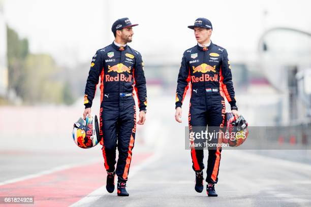 Daniel Ricciardo of Australia and Red Bull Racing and Max Verstappen of Netherlands and Red Bull Racing walk during Formula One winter testing at...