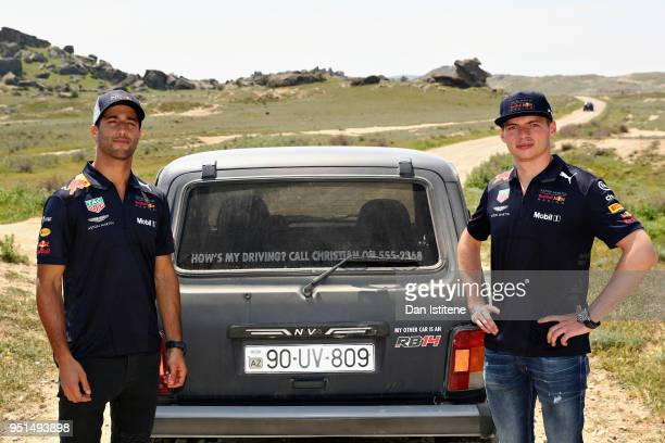 Daniel Ricciardo of Australia and Red Bull Racing and Max Verstappen of Netherlands and Red Bull Racing drive a Lada Niva in Gobustan Land of the...