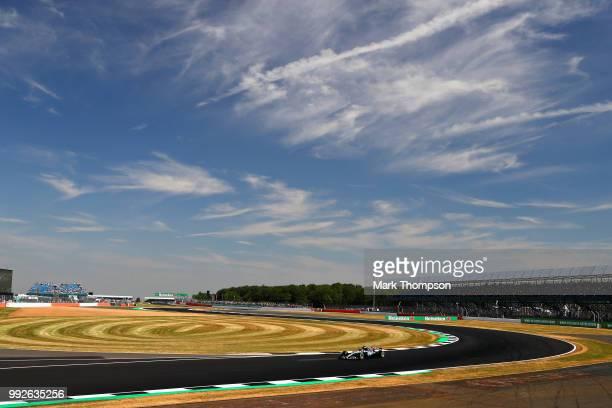 Daniel Ricciardo of Australia and Red Bull Racing and Red Bull Racing Team Principal Christian Horner meet Sir Jackie Stewart and Prince Edward Duke...