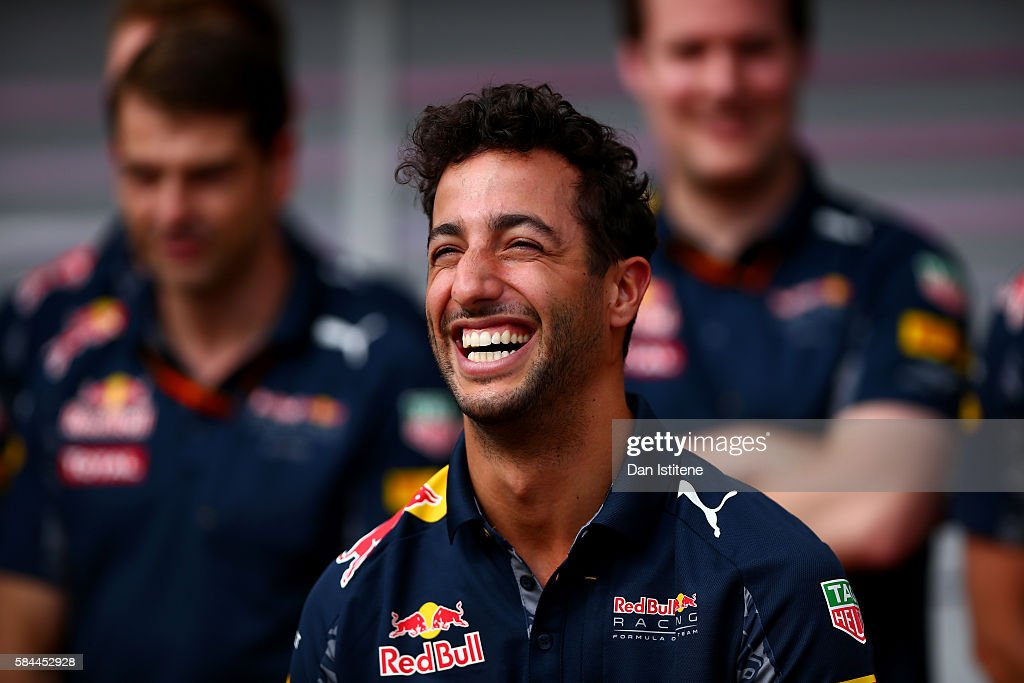 Daniel Ricciardo of Australia and Red Bull Racing and the Red Bull Racing team celebrate for Daniel's 100th F1 Grand Prix during previews to the Formula One Grand Prix of Germany at Hockenheimring on July 28, 2016 in Hockenheim, Germany.