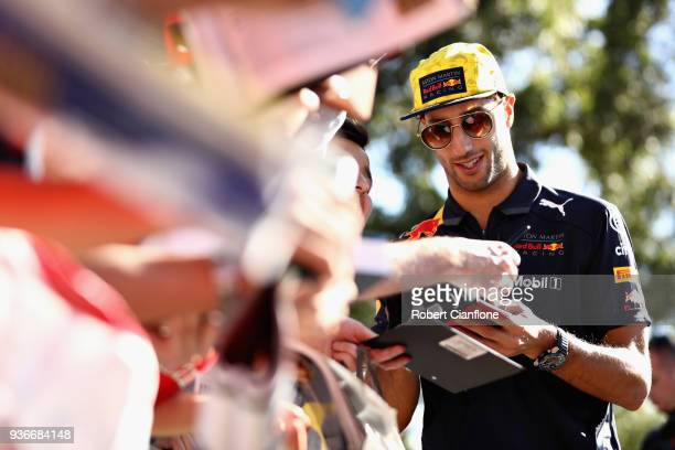Daniel Ricciardo of Australia and Red Bull Racing arrives at the circuit and signs autographs for fans before practice for the Australian Formula One...