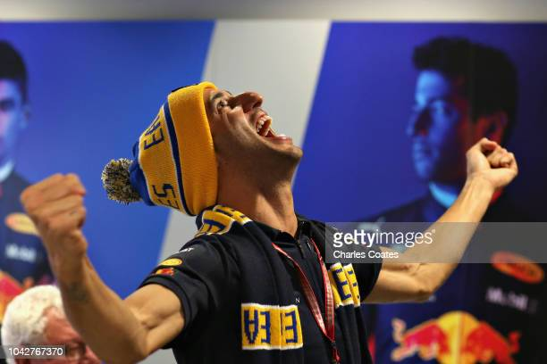 Daniel Ricciardo of Australia and Red Bull Racing celebrates as West Coast Eagles win the AFL Grand Final before final practice for the Formula One...