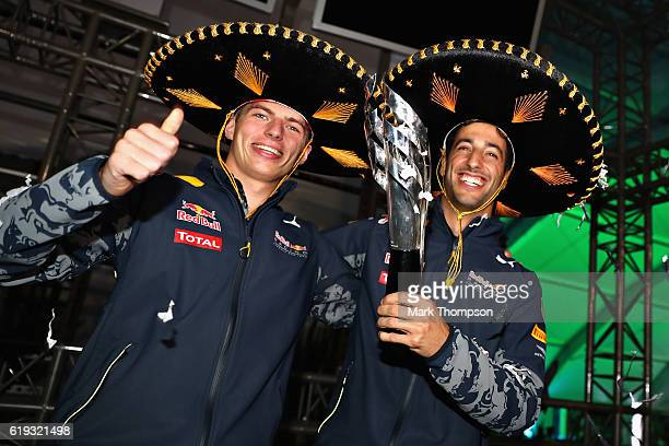 Daniel Ricciardo of Australia and Red Bull Racing celebrates getting third position with Max Verstappen of Netherlands and Red Bull Racing after...