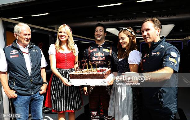 Daniel Ricciardo of Australia and Red Bull Racing celebrates his 27th birthday with a cake Red Bull Racing Team Consultant Dr Helmut Marko Red Bull...