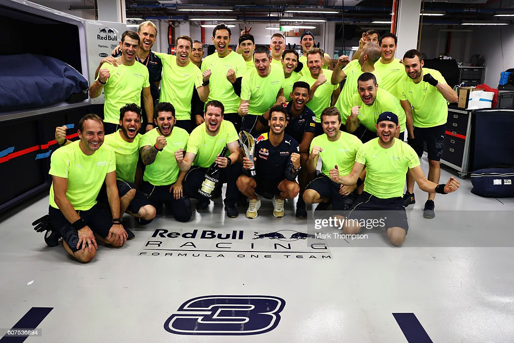 Daniel Ricciardo of Australia and Red Bull Racing celebrates his second placed finish with his team in the garage during the Formula One Grand Prix of Singapore at Marina Bay Street Circuit on September 18, 2016 in Singapore.
