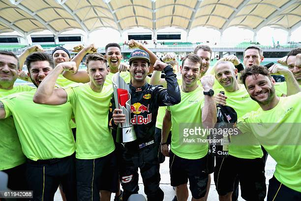 Daniel Ricciardo of Australia and Red Bull Racing celebrates his win with his team during the Malaysia Formula One Grand Prix at Sepang Circuit on...