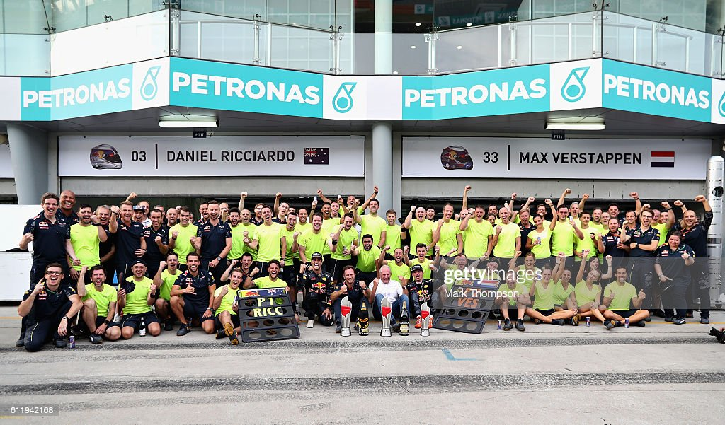 Daniel Ricciardo of Australia and Red Bull Racing celebrates his win with Red Bull Racing Team Principal Christian Horner, Red Bull Racing Team Consultant Dr Helmut Marko, Max Verstappen of Netherlands and Red Bull Racing and the rest of the team during the Malaysia Formula One Grand Prix at Sepang Circuit on October 2, 2016 in Kuala Lumpur, Malaysia.