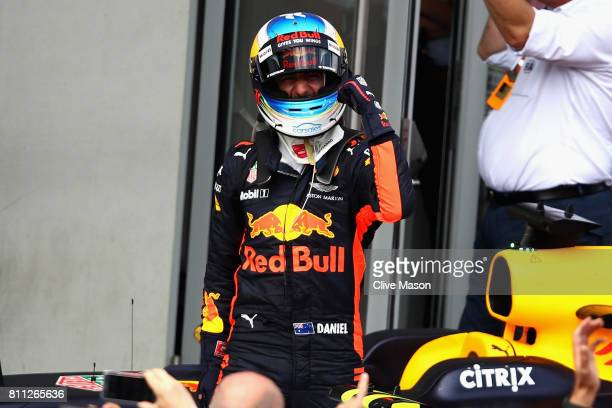 Daniel Ricciardo of Australia and Red Bull Racing celebrates finishing in third place in parc ferme during the Formula One Grand Prix of Austria at...