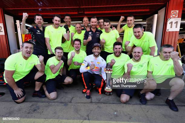 Daniel Ricciardo of Australia and Red Bull Racing celebrates finishing in third position with his race crew during the Spanish Formula One Grand Prix...